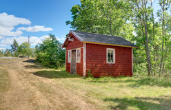 Traditional Swedish cabin painted in red color Royalty Free Stock Photos
