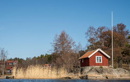 Traditional swedish house. View on a traditional swedish cottage on a country side royalty free stock photos