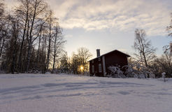Traditional Swedish House in Winter Sunset Royalty Free Stock Images