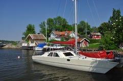 Traditional Swedish island village and sailboats Royalty Free Stock Image