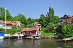 Traditional Swedish island village and sailboats Stock Photos