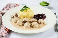 Traditional Swedish meatballs with mashed potatoes and red bilbe Royalty Free Stock Photography