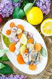 Traditional Swedish pickled herring with onions and carrots stock photography