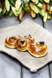 Traditional swedish saffron buns on hessian. Stock Image
