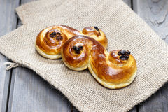 Traditional swedish saffron buns on hessian. stock photos