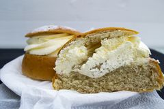 A traditional Swedish semla Fat tuesday roll sliced in half. stock image