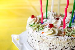 Traditional sweet birthday cake with colorful candles. Birthday cake with traditional colorful candles stock photo