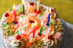 Traditional sweet birthday cake with colorful candles. Birthday cake with traditional colorful candles stock photography