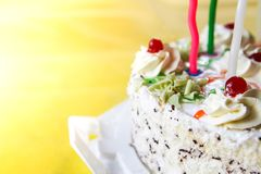 Traditional sweet birthday cake with colorful candles. Birthday cake with traditional colorful candles stock image