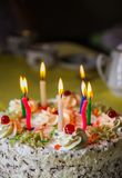 Traditional sweet birthday cake with colorful candles. Birthday cake with traditional colorful candles royalty free stock images