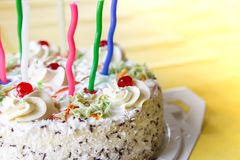 Traditional sweet birthday cake with colorful candles. Birthday cake with traditional colorful candles royalty free stock photo