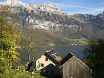Traditional swiss lake and houses landscape. Beautiful place named Walensee in the heart of the Swiis mountain Stock Images