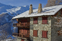 Traditional Swiss Mountain House. From the Herens district, built half from stone and half from wood. With snow covered mountains in the background Stock Images