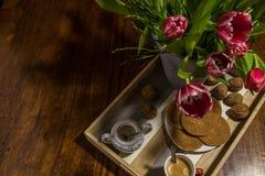 Traditional syrup waffles, dutch tulips, walnuts, sugar pot and stock photo