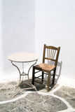 Traditional table and chair located on Mykonos island Stock Images