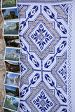 Traditional tablecloth. Closeup with traditional tablecloth and postacards from rasnov romania Royalty Free Stock Image