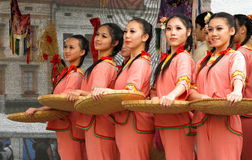 Traditional taiwan folklore. Famous folklore festival on the Klatovy square, Czech republic, Europe. Young girls from Taiwan in traditional clothes with baskets Stock Photo