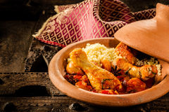 Traditional Tajine Dish with Chicken and Couscous Royalty Free Stock Images
