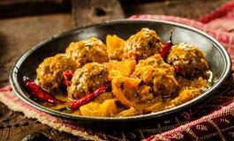 Traditional Tajine Dish of Yellow Curry Meatballs Stock Image