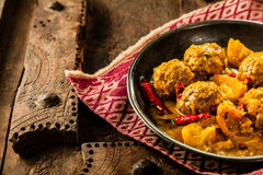 Traditional Tajine Dish of Yellow Curry Meatballs Royalty Free Stock Image