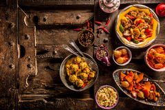 Traditional Tajine Dishes on Old Wooden Table Stock Photography