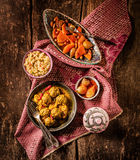 Traditional Tajine Dishes on Rustic Wooden Table Stock Photography