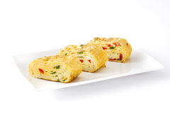 Traditional tamagoyaki Japanese omelette isolated. On white background royalty free stock images