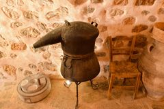Traditional tank for distillers from copper, production of alcohol, cognac, whiskey. Ancient traditional food technology. Greece. royalty free stock images