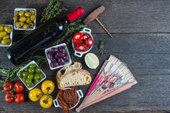 Traditional tapas buffet on wooden table from above Stock Images