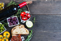 Traditional tapas buffet on wooden table from above Stock Image