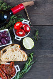 Traditional tapas buffet on wooden table from above Royalty Free Stock Image