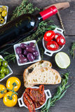 Traditional tapas buffet on wooden table from above Stock Photo