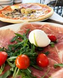 Traditional Italian pizza around lunch time in Rome, Italy royalty free stock images