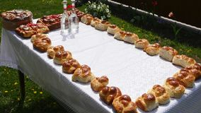 Traditional tasty ukrainian wedding bread loaf at the wedding table.  stock footage