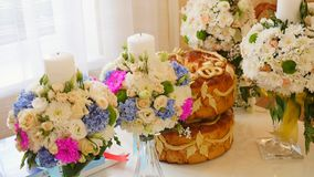 Traditional tasty ukrainian wedding bread loaf at the wedding table with weddind candles.  stock video footage