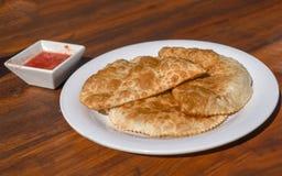Traditional Tatar pastry Chiburekki aka Cig borek on wooden table, Eskisehir, Turkey stock image