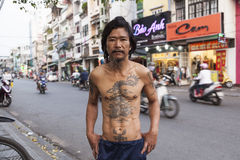 Traditional tattoo. Vietnamese man with traditional tattoos on his chest which symbolise his professional life royalty free stock photos