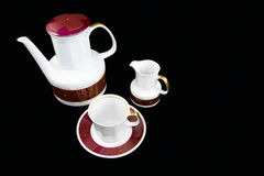 Traditional tea porcelain set. Cap, mug and cream cup Stock Photos