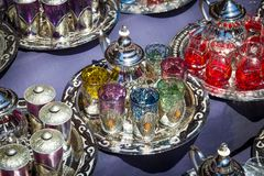 Tea pot sale. Traditional tea pots with tea glasses on a tray sold in the souks of Marrakesh, Morocco Stock Photos