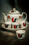 Traditional tea set, cups with teapot on fabric. Stock Photo
