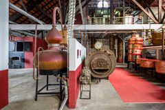 Traditional technology rum factory in Porto da Cruz, Madeira island. Royalty Free Stock Images