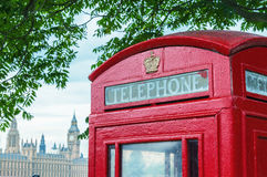 Traditional telephone booth along river Thames, Westminster Pala Royalty Free Stock Image