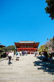 Traditional temple Hachiman Shrine with golden red roof against blue sky in Tokyo, Japan. The famous heritage, traditional temple Hachiman Shrine with golden red royalty free stock photo