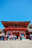 Traditional temple Hachiman Shrine with golden red roof against blue sky in Tokyo, Japan. The famous heritage, traditional temple Hachiman Shrine with golden red stock image
