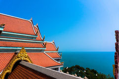 Traditional temple rooftop against blue sky Stock Image