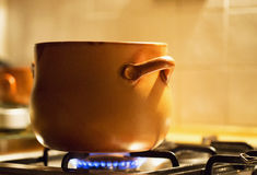 Traditional terracotta pot on the fire Royalty Free Stock Photos