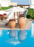 Traditional terracotta vases near the pool Stock Image