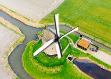 Typical ancient Dutch windmill with fields from above royalty free stock image