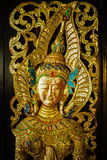 Traditional Thai Art on Temple door. In thailand Stock Image