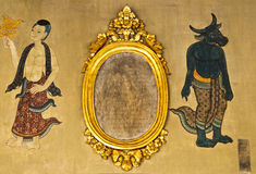 Traditional Thai art on a wall in a temp Stock Photos